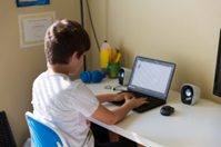 image of elementary student learning at home