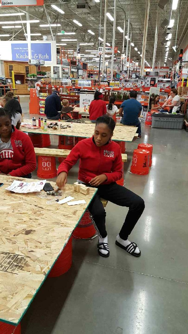 Pike High School Cheerleaders participated in a community service project on October 3 with Home Depot.
